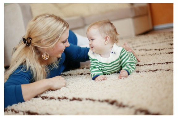 mom baby playing on carpet